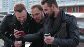 drby : Three handsome young men with beards smiling and taking selfie. Good-looking guys using a smartphone. Slow mo Dostupné videozáznamy