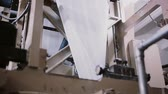 em linha : Paper in a printing machine. Printing establishment detail on production line with sound. Stock Footage