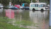 automóvel : JULY 20 2016 MINSK, BELARUS Flood on busy road in city streets after rain. City transport is stopped in centre of road.