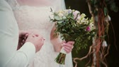 noivo : On a wedding day groom puts a golden ring on a bride finger. Close-up exchanging wedding rings Stock Footage