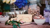 noz : Close-up view of wedding food bar. Summer wedding snack table. Flowers, cheese, nuts, figs and drinks. Vídeos