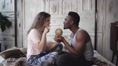 ırklararası : Man twist the globe, woman points with finger the location to traveling. Multiracial couple picking destination to trip.