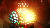 discoteca : Close-up view of light ball. Colored disco projector rounding. Light show shining in the dark in night club. Stock Footage