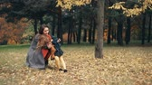 prazer : cute funny little girl having fun with mom in the amazing autumn park slow motion Stock Footage