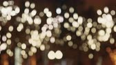 turva : Colorful, blurred, bokeh lights background in warm tone. Abstract sparkles.