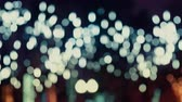 Боке : Colorful, blurred, bokeh lights background in cold tones. Abstract sparkles. Стоковые видеозаписи