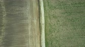 helicóptero : Aerial top view. Drone turning over the field. Beautiful countryside landscape of the empty meadow. Vídeos