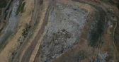 koku : Aerial drone shot of the garbage disposal site. Flight over the urban refuse dump. Big piles of trash. Stok Video