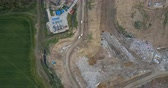 smród : Aerial top view of the garbage dump and waste management plant. Copter flying over the big pile of trash.