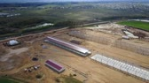 horticultura : Aerial view of the countryside. Building construction of agronomic industry, warehouse in the field. Stock Footage