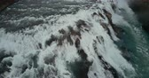 rozjímání : Aerial view of the turbulent flow of water in the cliffs. Copter flying over the powerful waterfall in Iceland.