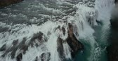north stream : Beautiful wild waterfall Gullfoss from the copter. Aerial view of the turbulent flow in Iceland nature.
