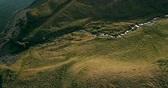 flow : Aerial view of the wild mountains river flows in the valley. Copter flying over the green fields in Iceland. Stock Footage