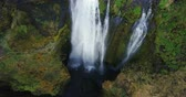chuva : Top view of the beautiful waterfall Gljufrabui in Iceland. Copter moving up, water falls down from the top of mountain.