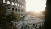 kolosszeum : Beautiful panoramic view of the Colosseum in Rome, Italy. Sunset landscape with historical building. Stop motion. Stock mozgókép