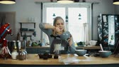 espátula : Young blonde woman cooking in the kitchen. Beautiful female preparing cream for decorating cupcakes, doing her hobby.