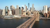 Нью Йорк : Aerial view of the Brooklyn bridge to Manhattan in New York, America through the East river in sunny day.