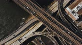 Нью Йорк : Aerial top view of traffic road in New York, America. Drone flying over traffic intersection on shore of East river. Стоковые видеозаписи