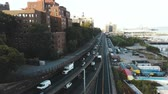 Нью Йорк : Aerial view of the road junction in Brooklyn, New York, America. Drone flying over the traffic track with many cars. Стоковые видеозаписи