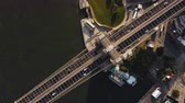 megalopolis : Aerial top view of Brooklyn bridge. Drone turning around the shore of East river in Brooklyn, New York, America. Stock Footage