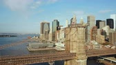 megalopolis : Aerial view of the Brooklyn bridge through East river to Manhattan in new York, America. Drone flying over the water.