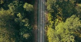 dráha : Drone top view of man running on train track. Escaping from past problems. Chasing dreams and surviving life trials. Dostupné videozáznamy