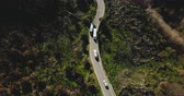 devir : Aerial view of vehicles on a narrow mountain road. Tour bus stops at roadside to let oncoming cars pass. Safety. 4K. Stok Video