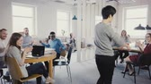 сумасшедший : Camera follows happy Asian man doing funny victory celebration dance walk in office, colleagues clap and laugh 4K.