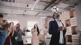 ceo : Happy black team leader juggles football on head. Multiethnic startup employees celebrate success in office slow motion