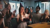 fajerwerki : Happy excited Caucasian girl holding birthday cake, multiethnic friends sing a cheerful song at fun party slow motion.