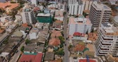 propriedade : Drone flying backwards over the town of Colombo, Sri Lanka. Aerial view of Asian cityscape with modern and old buildings