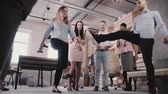 atmosfera : Multiethnic group plays with ball in modern office. Happy young employees enjoy healthy office atmosphere slow motion.