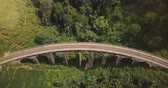 ceylon : Aerial view, drone descending over tourists walking on Nine Arch Bridge Ella in Sri Lanka, famous architecture sight.