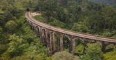 ceylon : Drone flying left and turning to reveal magnificent wide panoramic aerial view of Nine Arch Bridge Ella in Sri Lanka. Stock Footage