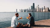 chicago : Romantic date on the shore of Michigan lake in Chicago, America. Beautiful couple enjoying a picnic together.