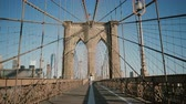 string : Romantic couple spin and dance at Brooklyn Bridge on a beautiful summer day. Happiness, relationship and love concept 4K