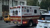 полиция : NEW YORK, USA, 18.08.2017 Accident. Emergency service on road. Ambulatory car riding near the police with siren light.