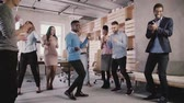 enthousiast : Happy African American employee dancing with colleagues at office party, celebrating business achievement slow motion. Stockvideo