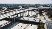 Drone flying around majestic Judge Pregerson highway road interchange in Los Angeles, USA with cars on multiple levels.