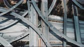 államközi : Drone rising over epic complex freeway intersection in Los Angeles with multiple levels, flyovers, junctions and bridges