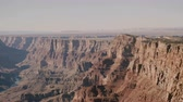 gran apertura : Amazing panoramic background shot of big eagle flying over epic sunny view of majestic Grand Canyon national park USA. Archivo de Video