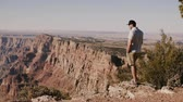 gran apertura : Happy young adult local American man excited by epic sunny summer scenery of famous Grand Canyon national park USA.