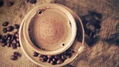 taza : Cup of coffee with coffee beans