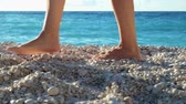 banho de sol : Closeup womans legs walking on a beach at sunset over a sea. Slow motion footage