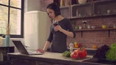 reading : Female enjoy wine and working in apartment. Stock Footage