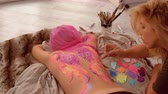 značení : Fascinating artwork on a humans body. Colorful wings on a womans back.