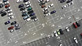 Panorama of a car park, view from above. It reflects a number of cars that remain staticly on their parking lots. Theres a lot of cars and signs, the ground is grey. Stock Footage