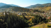 carpathians : view of a pine village in the mountains the drone flies down sunny day small village landscape
