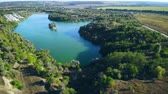 mere : aerial view lake with blue water surrounded by green trees and bushes beautiful country landscape in summer season