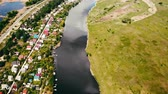 bouwgrond : aerial view on the township surrounded river with blue water beautiful houses summer season Stockvideo